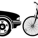 Picture of a car and bicycle head to head