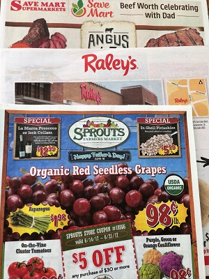 Picture of grocery store weekly ads for grocery shopping satisfaction