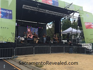 Photo of Jessica Malone performing at the Sacramento Farm-to-Fork Festival